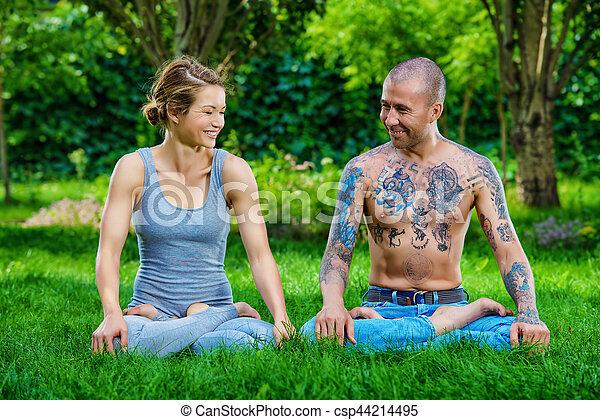 family yoga man and woman yogi doing various yoga poses