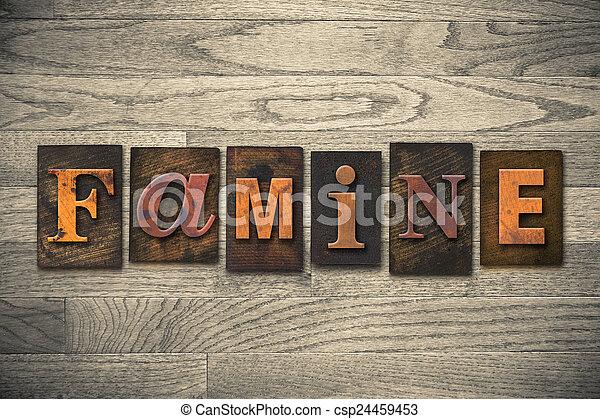 Famine Concept Wooden Letterpress Type - csp24459453