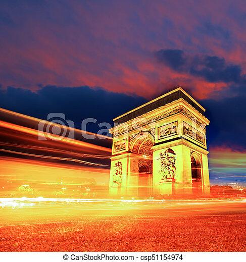 famous arc de triomphe at night in paris france