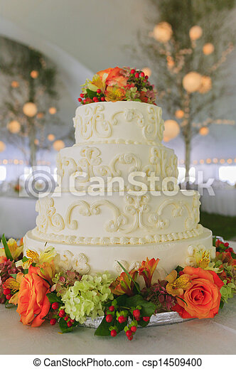 Fancy wedding cake inside a large event tent. - csp14509400