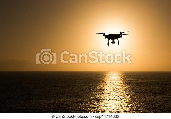 Tenerife, SPAIN - 13.02.2017 dron DJI fantasma 4 al atardecer en vuelo en Tenife - csp44714632