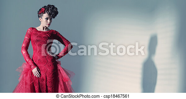 Fantastic woman wearing fashionbable red dress - csp18467561