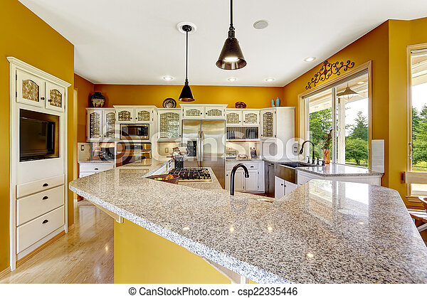 Farm house interior. Luxury kitchen room with big island and gra - csp22335446