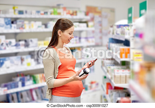farmacia, smartphone, mujer felíz, embarazada - csp30091027