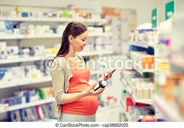 farmacia, smartphone, mujer felíz, embarazada - csp38662025