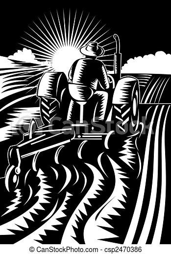 Farmer on tractor plowing field - csp2470386