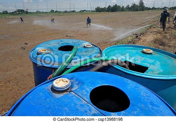 farmer spray pesticide on the rice field  - csp13988198
