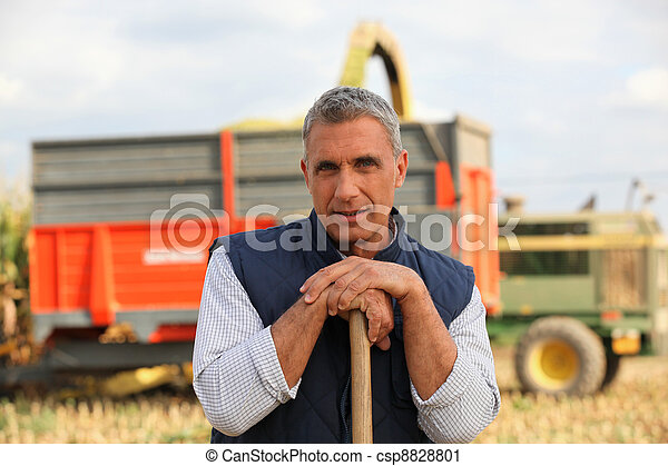 Farmer standing in front of a cattle transport vehicle - csp8828801