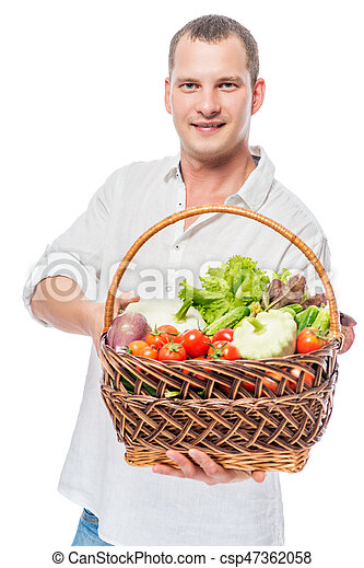 Farmer with a basket full of vegetables on a white background - csp47362058