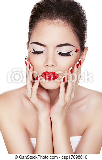 Fashion Beauty. Manicure and Make-up. Nail art. Beautiful Woman With Colorful Nails and Luxury Makeup. Beautiful Girl Touching her Face - csp17698610