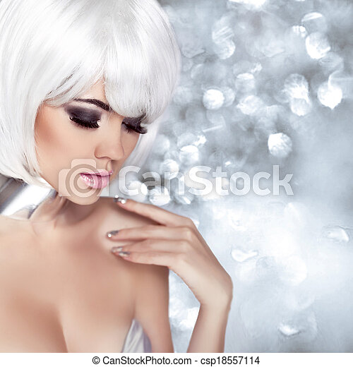 Fashion Blond Girl. Beauty Portrait Woman. Makeup. White Short Hair. Isolated on blinking Christmas Background. Face Close-up. Manicured nails. Vogue Style. - csp18557114