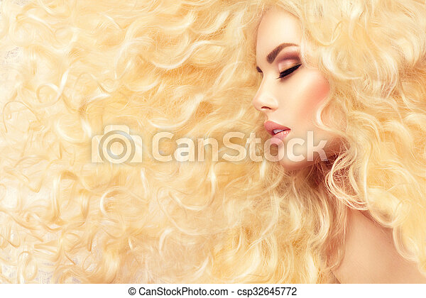 Fashion blond girl with healthy long wavy hair - csp32645772