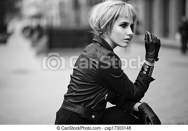 Fashion blond model in teenager style in wig outdoors on the street - csp17303148