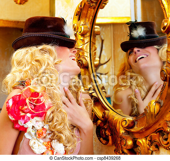 fashion blond woman with hat in baroque golden mirror - csp8439268
