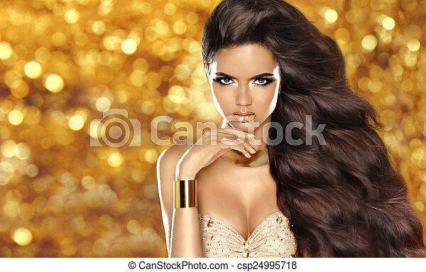Fashion brunette girl with Long wavy hair, beauty makeup, luxury - csp24995718