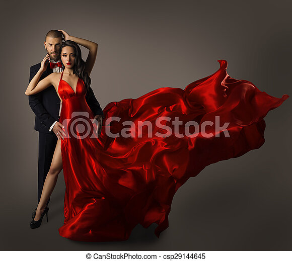 fashion couple portrait woman red dress man suit long