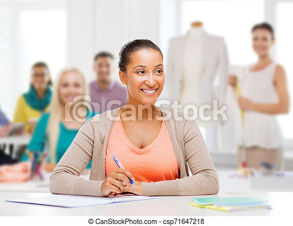 Education Clothing And Tailoring Concept Smiling African American Female Student Or Fashion Designer With Notebook Over Canstock