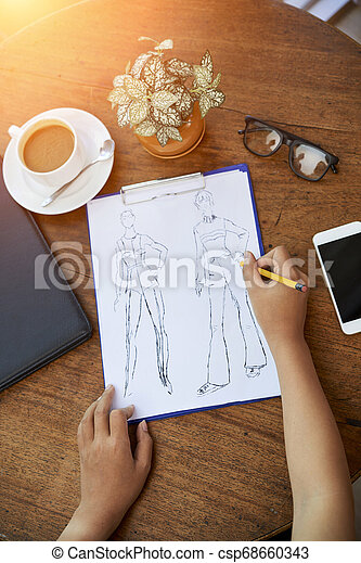 Fashion Designer Working On Collection Hands Of Fashion Designer Sketching Models For New Collection