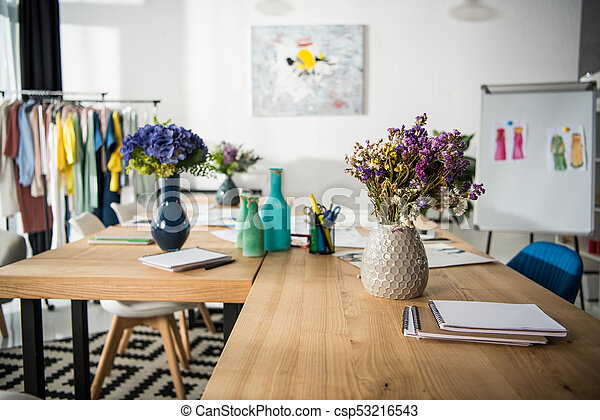 Fashion Designer Workplace Flowers In Vases On Table In Clothing Design Studio