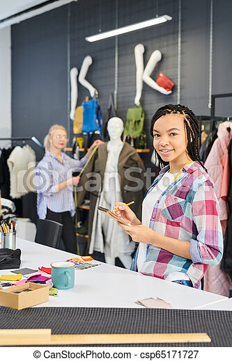 Fashion Designers Sewing Clothes Fashion Designers Team Working In Clothes Design Studio Together Woman Drawing Sketches