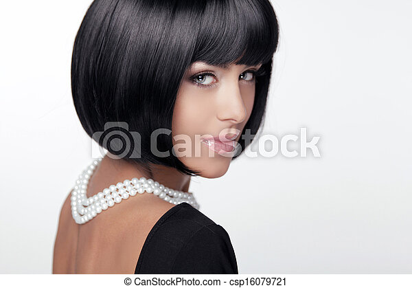 Fashion Haircut. Hairstyle. Sexy Lady. Stylish Fringe. Short Hair Style. Brunette woman with jewelry pearls  - csp16079721
