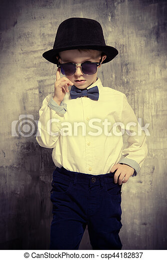 5adc5ffbf Fashion kid. Cute little boy in elegant clothes and sunglasses. be ...