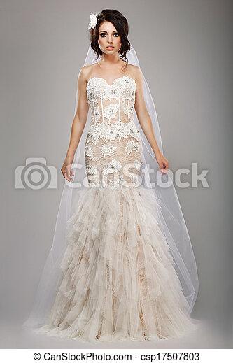 Fashion model classy bride in long wedding dress and veil.