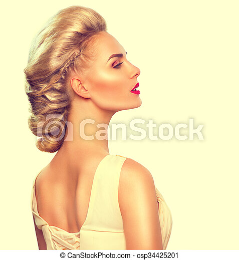 Fashion model girl portrait with updo hairstyle - csp34425201