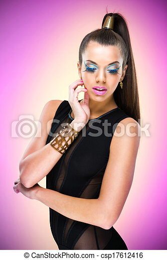 Fashion Model with luxury makeup and clothes - csp17612416