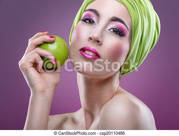 Fashion modell with beautiful pink makeup and green apple - csp20110486