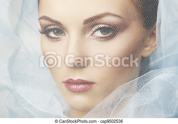 Fashion photo of beautiful women under blue veil - csp9502536
