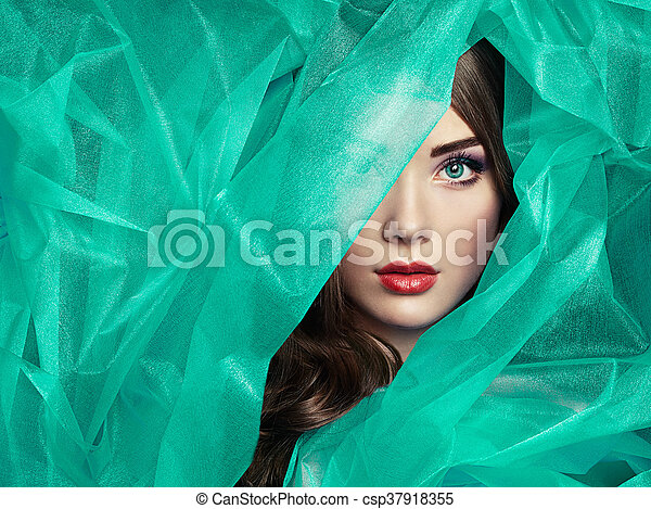 Fashion photo of beautiful women under turquoise veil - csp37918355