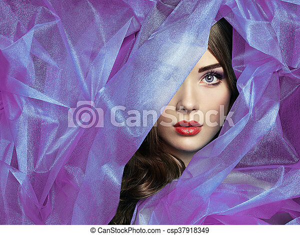 Fashion photo of beautiful women under purple veil - csp37918349