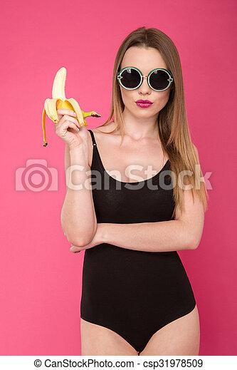 Fashion photo of glamourous woman with banana - csp31978509