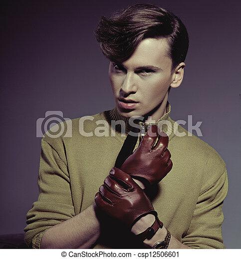 Fashion photo shot of a man wearing gloves - csp12506601