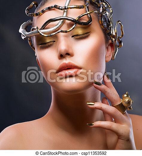 Fashion  Portrait. Gold Makeup - csp11353592