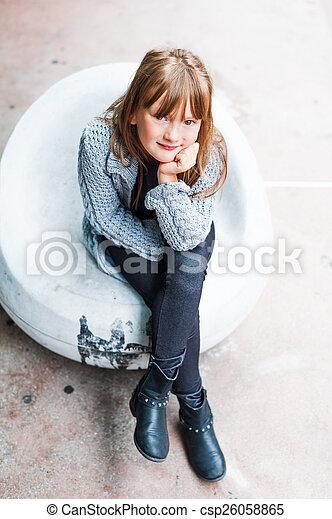 Fashion Portrait Of A Cute Little Girl Wearing Black