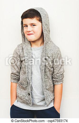 Fashion Portrait Of Adorable Kid Boy Wearing Hood Jacket Canstock
