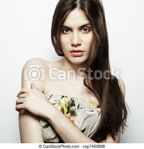 Fashion portrait of young beautiful elegant woman with dark hair - csp7450898