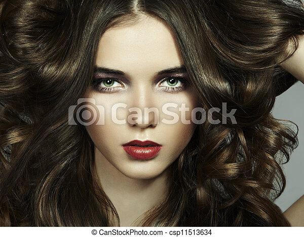 Fashion portrait of young beautiful woman - csp11513634