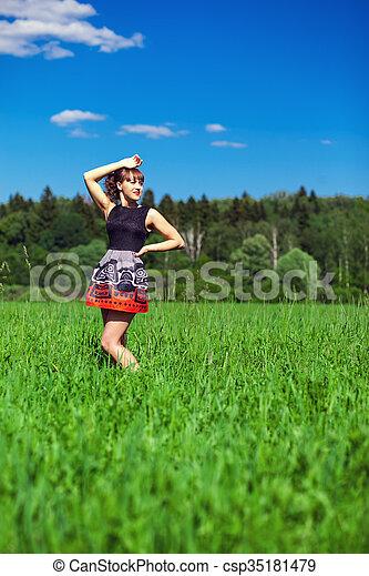 Fashion portrait of young sensual woman in garden - csp35181479