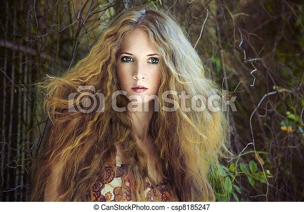 Fashion portrait of young sensual woman in garden - csp8185247