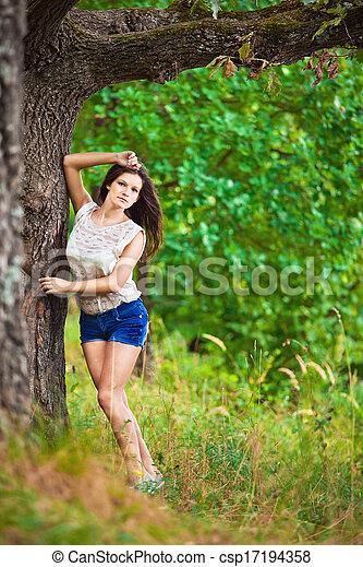 Fashion portrait of young sensual woman in garden - csp17194358