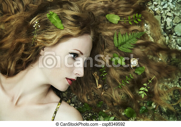 Fashion portrait of young sensual woman in garden - csp8349592