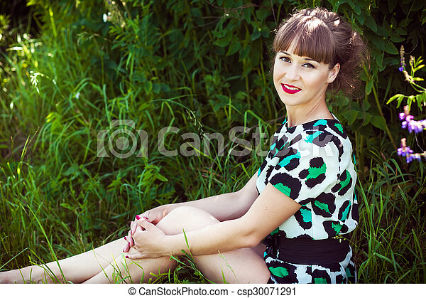 Fashion portrait of young sensual woman in garden - csp30071291