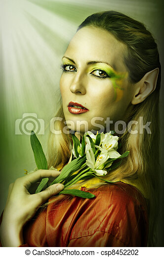 Fashion portrait of young sexy woman with creative green spring or summer make-up - csp8452202