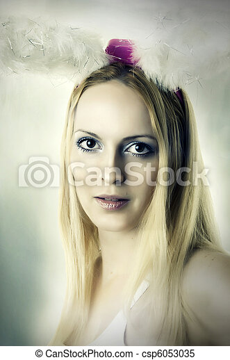 Fashion portrait of young woman with bunny ears - csp6053035