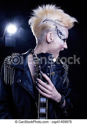 Fashion Rocker Style Model Girl Portrait. Hairstyle. Punk Woman Makeup, Hairdo and black Nails. Smoky Eyes - csp41459976