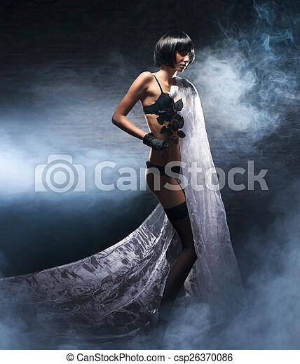 Fashion shoot of young bizarre woman in fetish dress - csp26370086