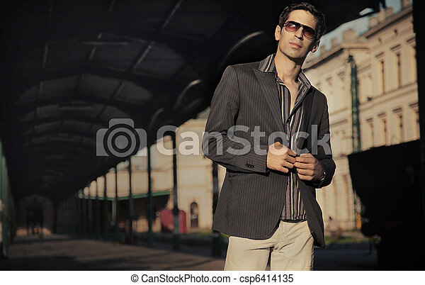 Fashion style photo of an handsome elegant man - csp6414135
